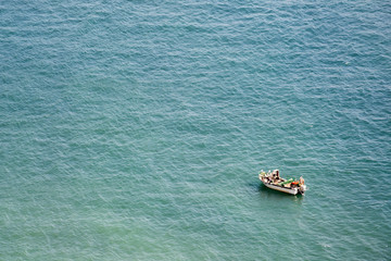 Fishermen working on a boat on the mediterranean sea