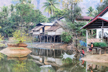 Girls fishing at the village of Ban Kong Lo