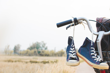 Jeans sneakers and bag on  bicycle ,Concept journey,hipster tone