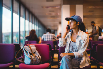 Young woman waiting at airport lounge