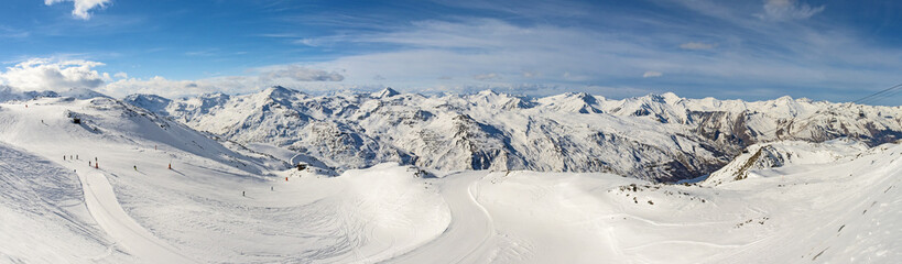 Wall Mural - Panoramic view of mountain range with ski piste