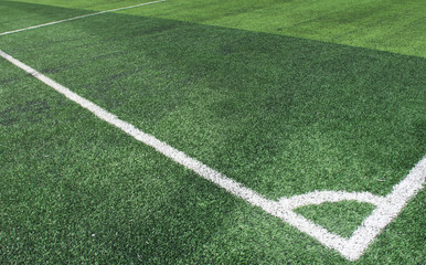 Soft focused picture of  The corner of Football field  or soccer field covered with artificial grass