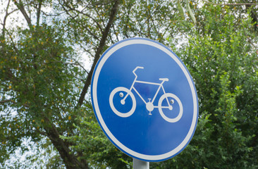 Soft focused picture of  Blue bicycle sign with nature background