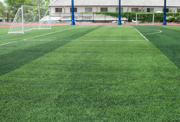 Soft focused picture of  Football field  or soccer field covered with artificial grass