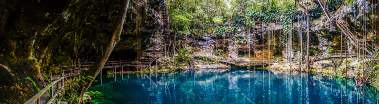 Panorama of the blue X'Canche Cenote close to Ek Balam near Valladolid, Yucatan peninsula, Mexico.