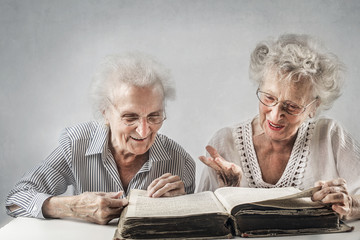 Elderly women reading a book