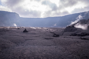 View of smoking big crater in Volcanoes National Park, Big Island of Hawaii, US