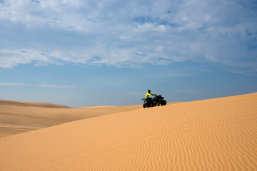 ATV funny racing on sand dune in Mui-Ne city, Vietnam