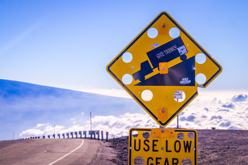 Sign on Mauna Kea, Big Island Hawaii, US. On the world's highest mountain base to top 10.200m Mauna Kea the wind is so strong that street signs need to have holes to resist the wind