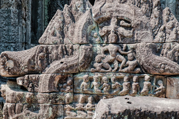 Fragment of old wall in the Preah Khan Temple in Siem Reap, Cambodia. Selective focus