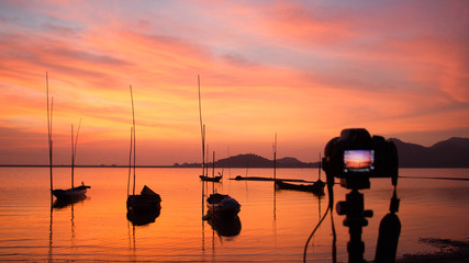 Camera standing on tripod at sunset at the sea in Thailand; landscape