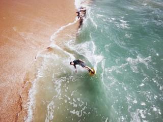 High Angle View Surfer On Sea