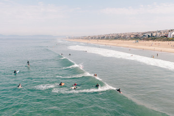 High Angle View Of People Surfing At Beach