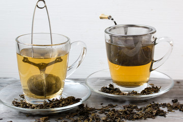 Green tea. Strainer. Grey wooden background. Copy space