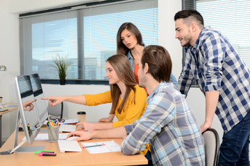 group of young cool hipster creative business people in casual wear working together in meeting room of a startup company