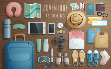 Wall Mural - Travel accessories prepared for the trip on wooden background.