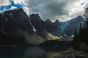 Stormy sky above mountains and lake
