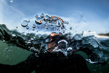 View of water bubbles and blurred figure from underneath