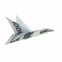 origami airplane from banknotes