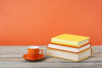 Cup of tea and books on wooden table Education background.Back to school.Copy space for text.