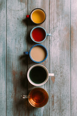 Different types of tea on a grunge blue wooden background