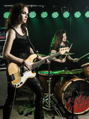 Women playing in the rock band