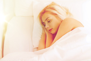 young woman sleeping in bed at home bedroom