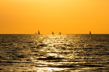 Sunset on Atlantic ocean with the boats on the horizon