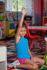 Little girl asking a question in pre school
