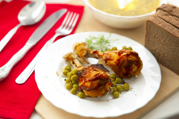 chicken legs on white plate with sauce