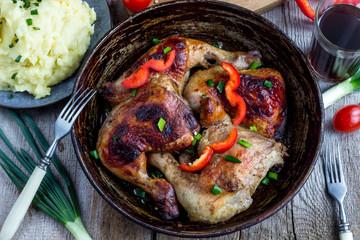 chicken legs  on cast iron pan