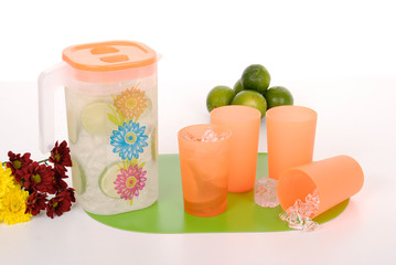 pitcher for juice and four plastic cups