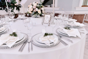 Well decorated guest numbered table in tenderless wedding hall