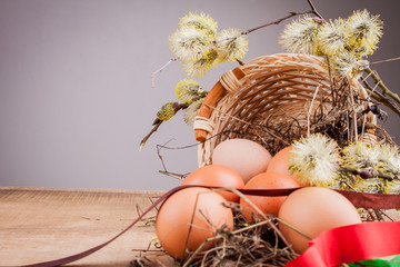 Natural Easter eggs on the wooden table