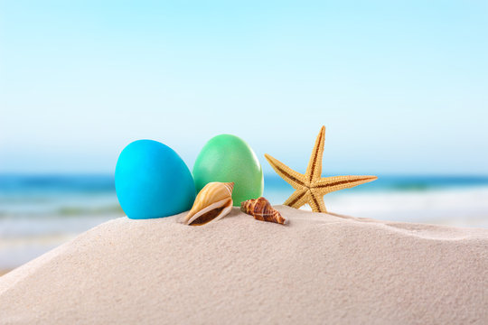 Easter eggs with sand, on white background