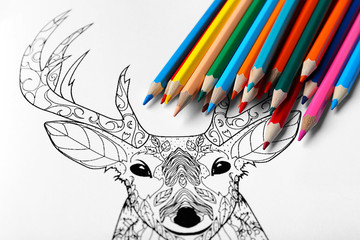 Colouring picture and pencils, closeup