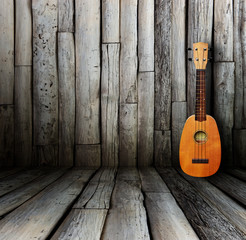 Ukulele in vintage wood room.