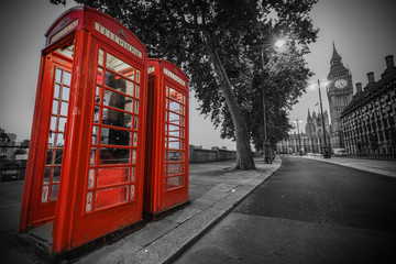 Traditional red phone booth in London with the Big Ben in the background