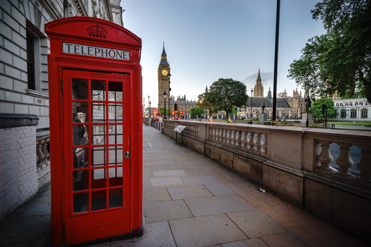 Traditional red phone box in London with the Big Ben in the background