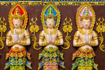 three fairy statues
