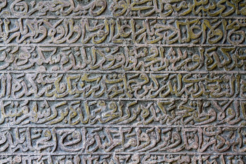 Old arabic scriptures in cemetery.