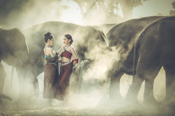 Two beautiful Asian woman and elephant