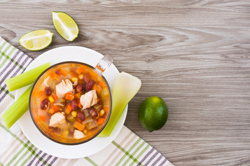 Mexican soup with chicken, celery and vegetables
