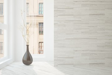 White empty room with vase and urban landscape in window. Scandinavian interior design