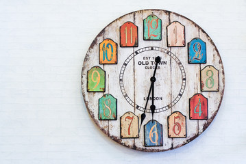 Vintage clock on white wall.