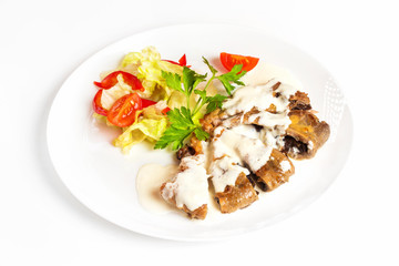 Plate of vegetables and meal of minced meat with mushrooms isolated at white background.