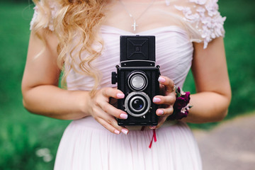 Girl with an old camera in hand