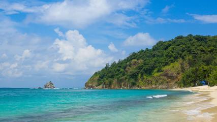 Tropical Beach Scene With Rocky Island