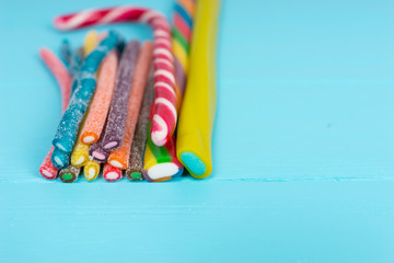 Colorful delicious licorice candies on wooden board
