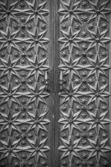 Closeup of ornate wooden medieval door in Sitges, Barcelona (Spain)